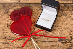 Diamond ring and heart shaped candies Royalty Free Stock Photo