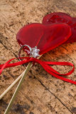 Diamond ring and heart shaped candies Royalty Free Stock Images