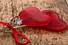 Diamond ring and heart shaped candies Royalty Free Stock Photos