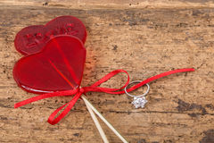 Diamond ring and heart shaped candies for valentine Stock Photos