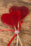 Diamond ring on heart shaped candies Royalty Free Stock Photography