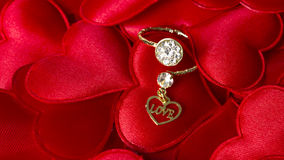Diamond Ring on Hearts. With a Love Typed in a Heart Stock Images
