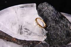 Diamond ring and ice Stock Photo