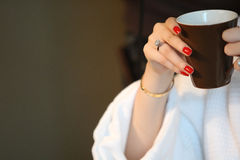 Diamond ring on lady's finger. ,hands holding a cup Stock Photography