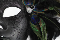 Diamond ring on peacock feathers with decorative mask Stock Photos