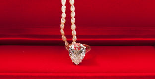 Diamond ring and pearl necklace with red box Stock Photo