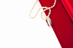 Diamond ring and pearl necklace with red box Royalty Free Stock Photo