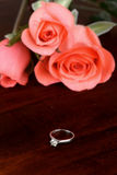 Diamond ring and pink rose Stock Photos