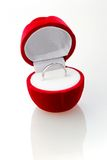 Diamond ring in the red box. Wedding ring of white gold with a little brilliant in the red box Stock Image