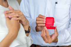 Diamond ring in red box on hand  for couple Stock Photos