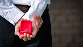 Diamond ring in red box on hand  for couple Royalty Free Stock Photography