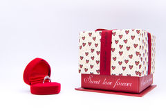 Diamond ring in the red heart box with gift box isolated on whit Stock Photo