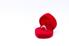 Diamond ring in the red heart box isolated on white background Stock Photos