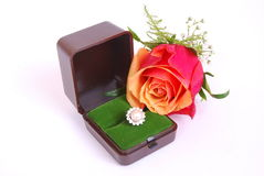Diamond ring with red rose Royalty Free Stock Photo