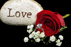 Diamond ring with red rose and rock Royalty Free Stock Photography