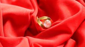 Diamond Ring On Red Satin arkivfoto