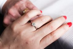 Diamond ring on two hands wedding romantic. Diamond ring romantic wedding  red nail Stock Images
