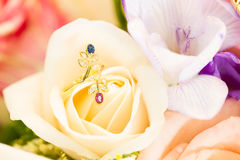 Diamond ring on rose Stock Photography
