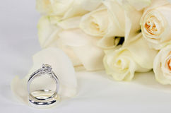 Diamond ring and roses Stock Photography