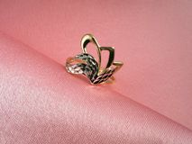Diamond ring on rosy silk Stock Images