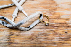 Diamond ring on a shoelace Stock Photography