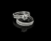 Diamond ring shot on a black reflective background Royalty Free Stock Image