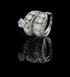 Diamond ring shot on a black reflective background Royalty Free Stock Images
