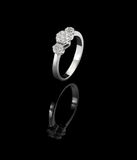 Diamond ring shot on a black reflective background Royalty Free Stock Image