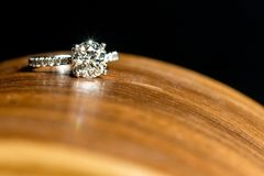 Diamond Ring On Top Of Curved Wood Platform, Visible Sparkle stock image