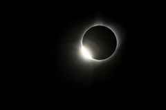 Diamond ring Total Eclipse USA 2017. As the sun shines through the valleys of the moon a bright diamond ring is visible during the Total Eclipse USA 2017 Stock Images