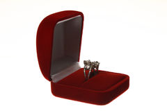 Diamond ring in a velvet red box. On white background royalty free stock image