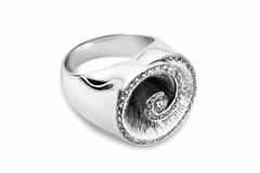 Diamond ring in white gold. Diamond ring with a large amount of diamonds arranged in a spiral form Stock Photography