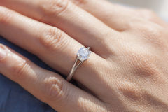 A diamond ring. A woman hand wearing a diamond ring Royalty Free Stock Photography