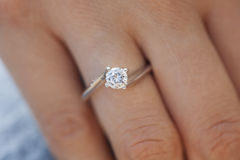 Diamond ring. A woman hand wearing a diamond ring Stock Images