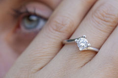A diamond ring. A woman hand wearing a diamond ring Royalty Free Stock Image