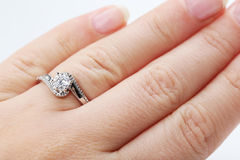 Diamond ring. On the woman's finger Stock Photography