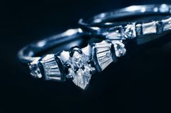 Diamond rings. On vlack background stock image