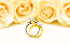 Diamond rings and roses Royalty Free Stock Photos