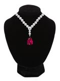 Diamond and ruby necklace on black mannequin isolated on white Stock Image