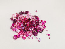Diamond (ruby) stones heap over silk Royalty Free Stock Images