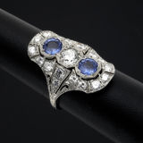 Diamond and sapphire ring. Diamond and sapphire women's ring on black Royalty Free Stock Images