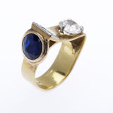 Diamond and Sapphire Ring. Unusual diamond and sapphire ring on white Stock Image