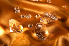 Diamond on satin fabric Stock Photos