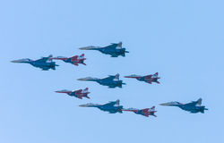 Diamond-shape of 4 Mig-29 The Russian Knights and five Su-27 Swifts Stock Photo