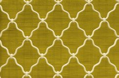 Diamond shape of white curved wrought iron steel on the lattice window, yellow bamboo curtain background, vintage style lattice. Work for house decoration royalty free stock images