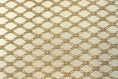 Diamond-shaped lattice on a beige background. Background for design and decoration.  stock images