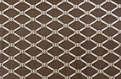 Diamond-shaped lattice on a brown background. Background for design and decoration.  stock images
