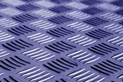 Diamond shaped metal floor pattern with blur in blue tone. Abstract background and texture for design Stock Image