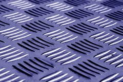 Diamond shaped metal floor pattern with blur effect in blue tone Royalty Free Stock Photography