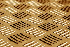 Diamond shaped metal floor pattern with blur effect in brown ton Stock Photography
